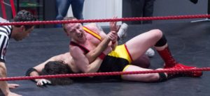 Wrestler performing an armbar