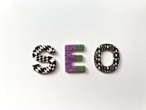 A colourful SEO logo as an introduction to 'How to write an SEO article'