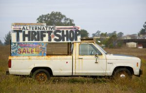 An old truck giving directions to a thrift shop - cheap copywriting